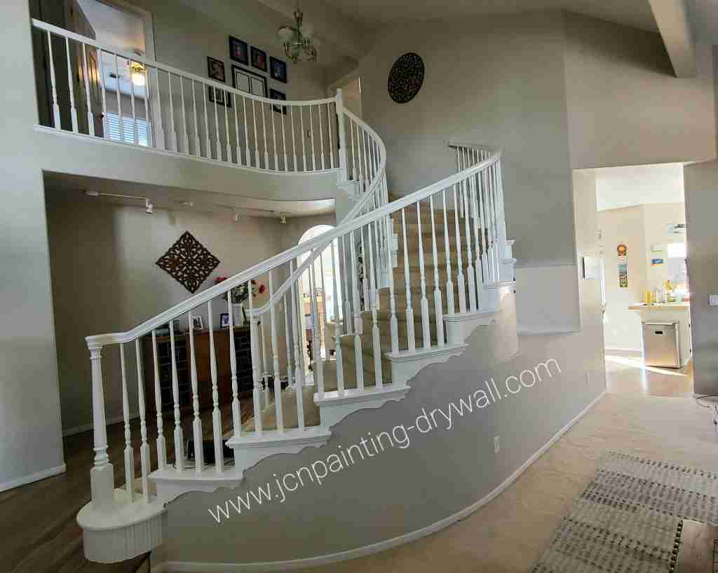 Beautiful-home-with-gray-color-painted-walls-and-white-color-painted-metal-stairs